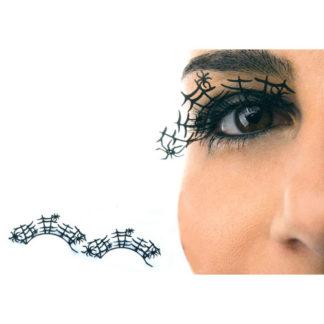 Ciglia nere con ragnatele e ragni