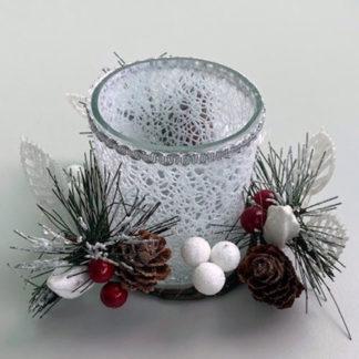 Portacandela in vetro con bacche e pigne